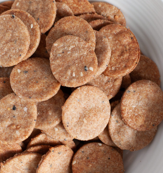 Close up of Whole wheat everything bagel crackers in a bowl