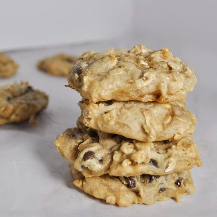 Four oatmeal chocolate chip cookies stacked on top of each other