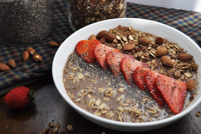chocolate granola and mocha overnight oats with strawberries