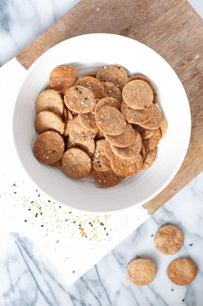 Whole wheat everything bagel crackers in a bowl