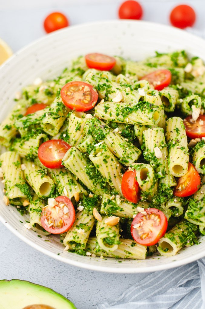 Close up of pesto on pasta with cherry tomatoes