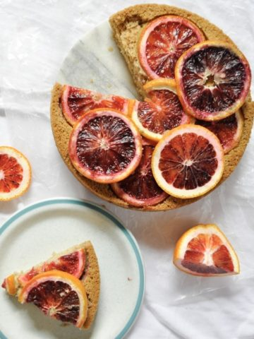 Cake topped with blood oranges