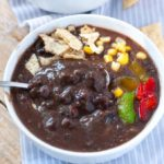 Black bean soup in white bowl