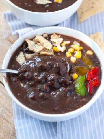 Black bean soup in white bowl