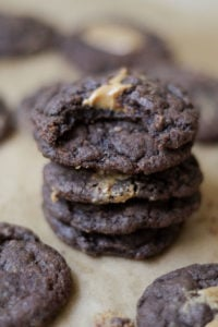 Four dark brown cookies stacked on top of each other