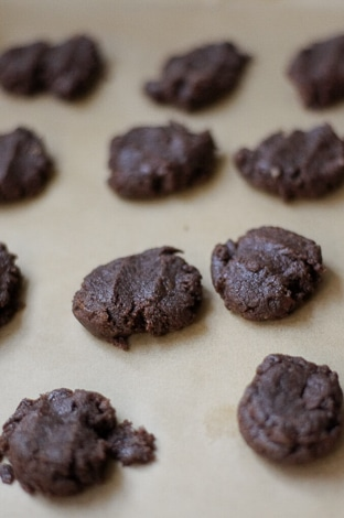 Chocolate cookie dough on parchment paper