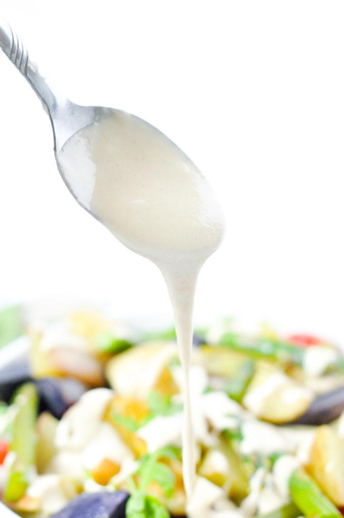 lemon tahini dressing on spoon