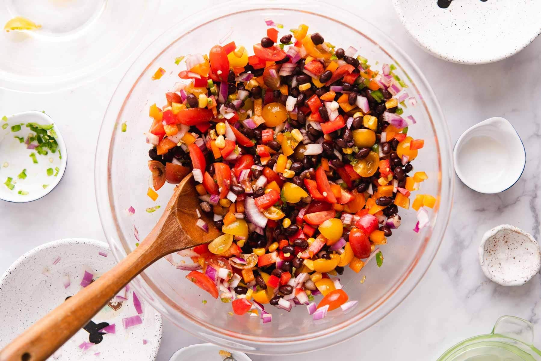 Overhead view of large glass bowl filled with black bean salsa