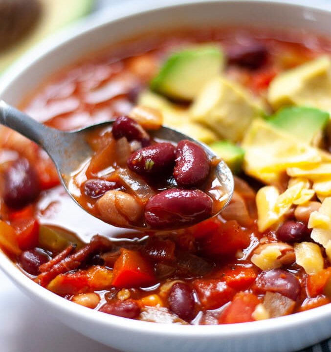 Spoonful of veggie chili with avocados