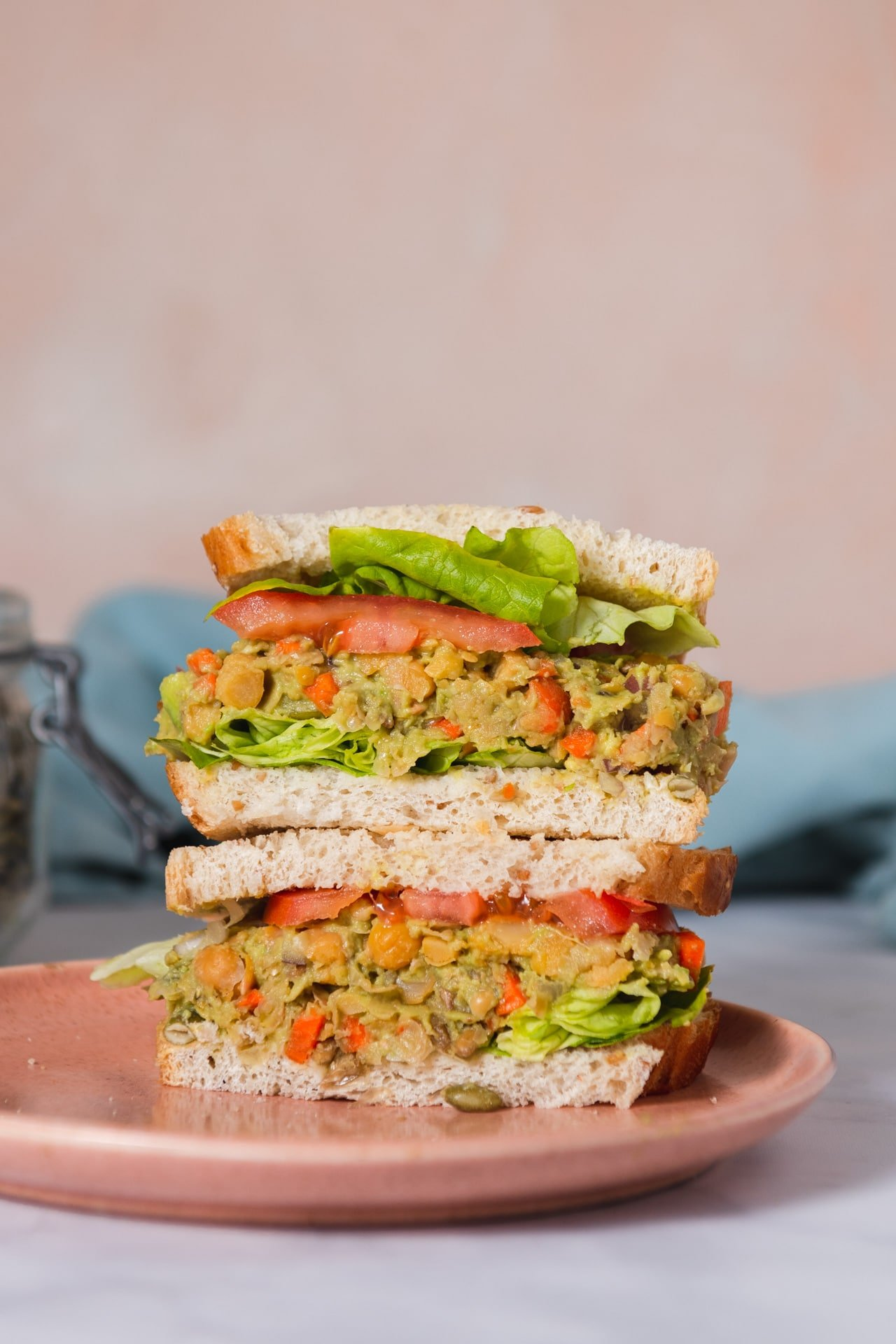 Two halves of chickpea sandwich stacked on top of each other