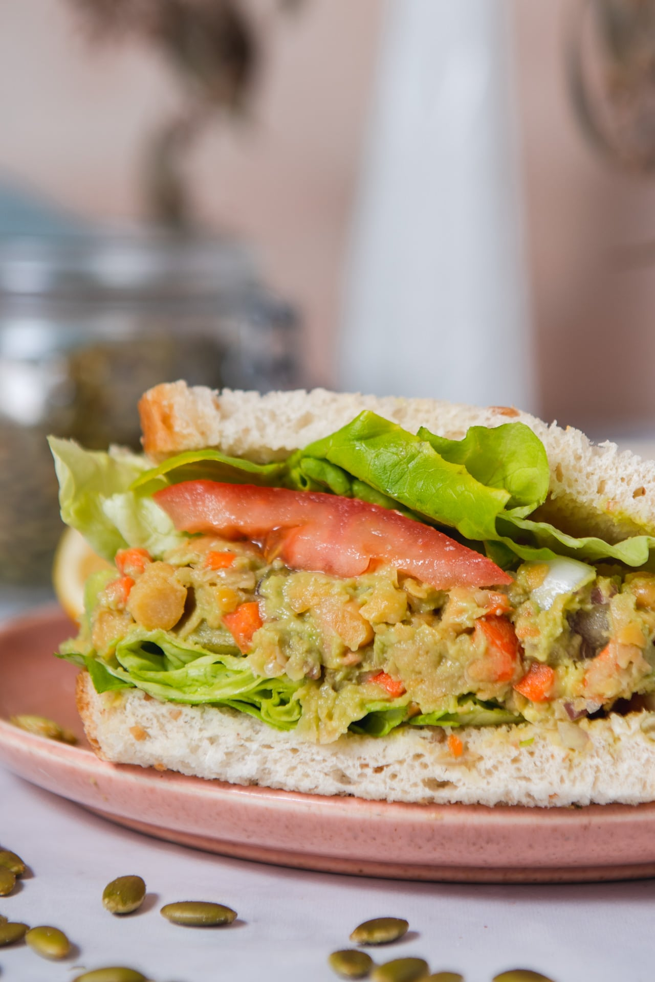 Close up of smashed avocado chickpea sandwich