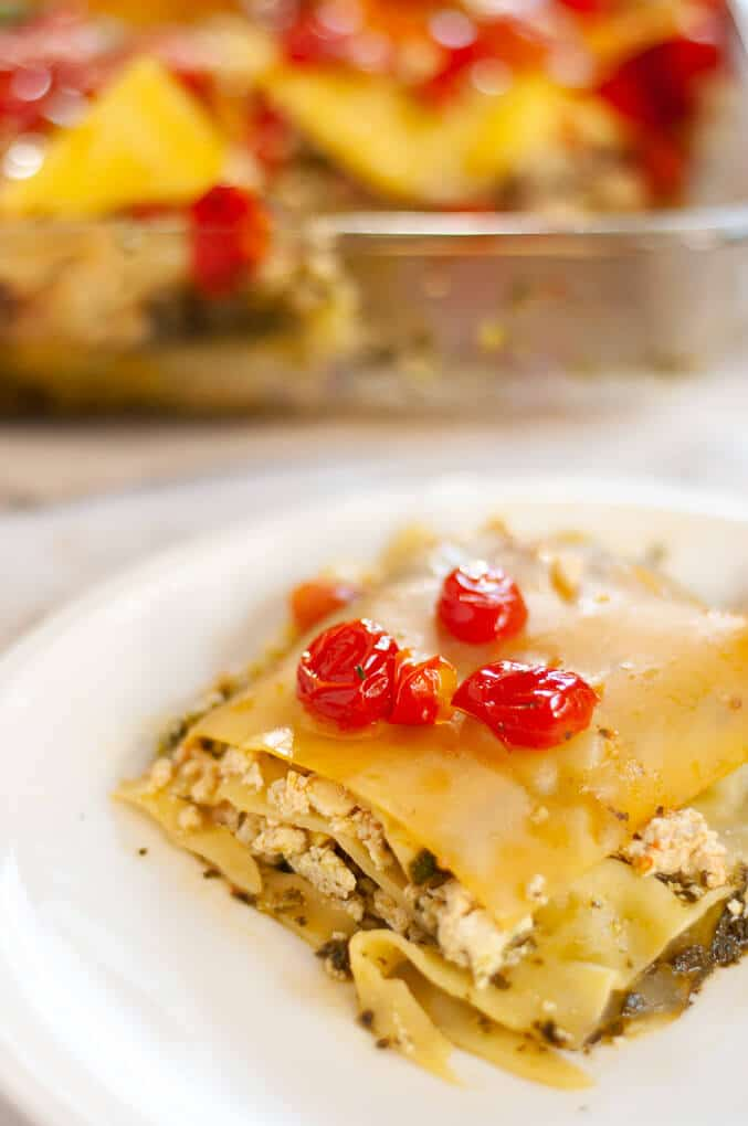 Slice of pesto lasagna on white plate