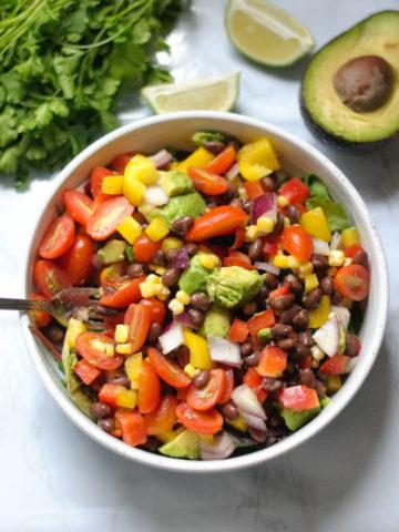 Black bean salad in large white bowl