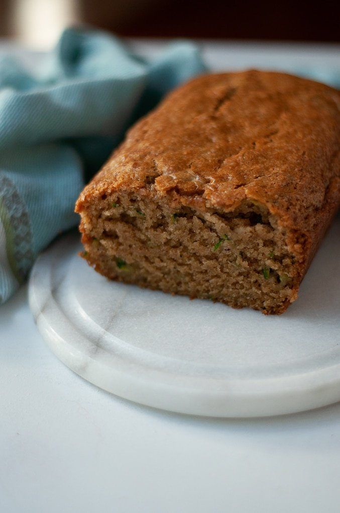 Close up of sliced loaf of zucchini bread.
