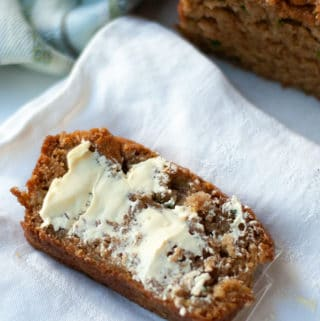 Slice of vegan zucchini bread with butter