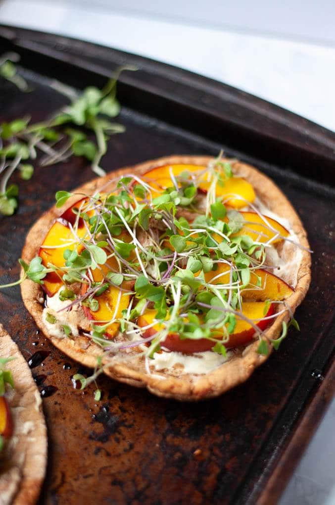 Pita pizza on baking sheet