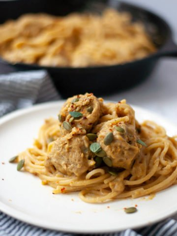 Pasta with meatballs on a white plate