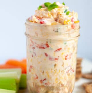 Side view of jalapeno pimento cheese and celery
