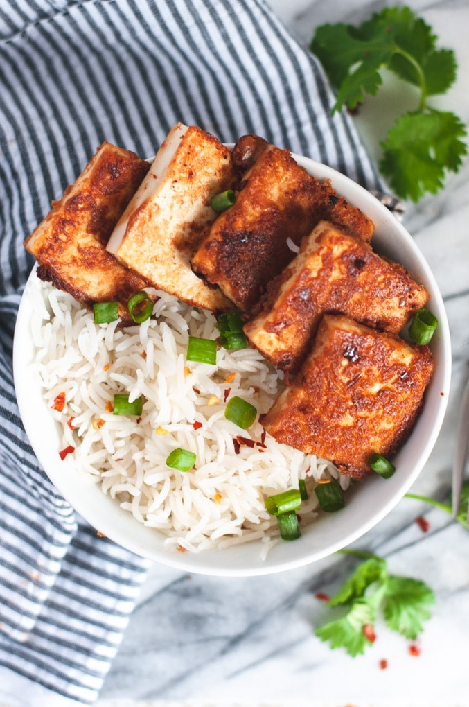 Tofu and rice in white bowl