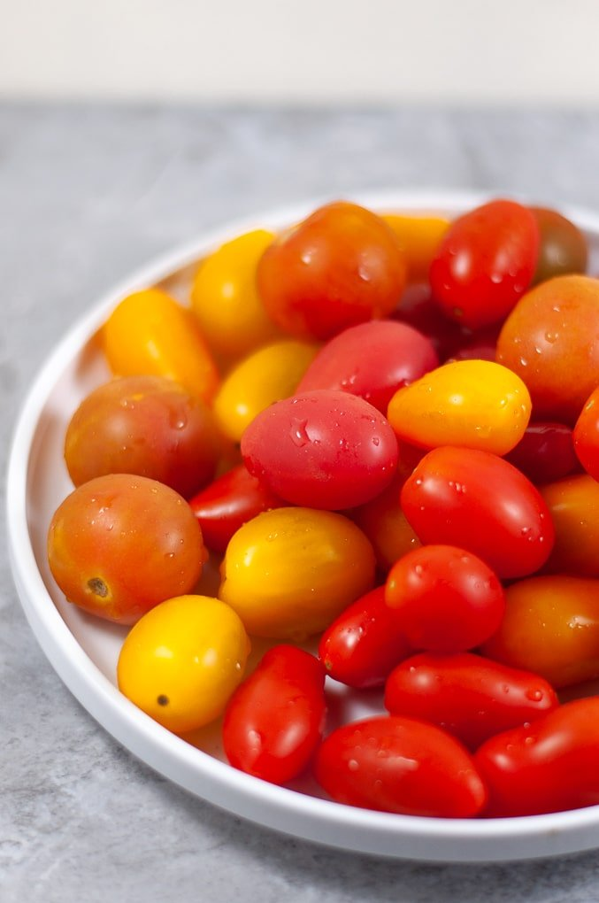 Close up of cherry tomatoes on a plate