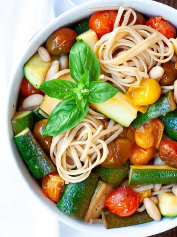 Cherry tomato pasta mixed together and topped with basil