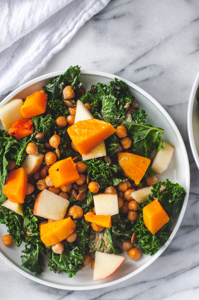 Overhead view of kale salad on marble background