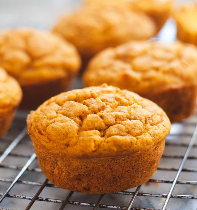 Vegan pumpkin muffin cooling on wire rack