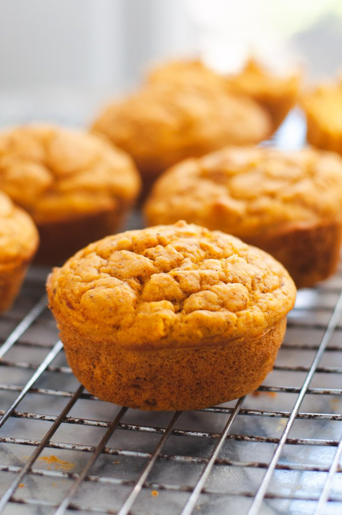 Vegan pumpkin muffin cooling on wire rack