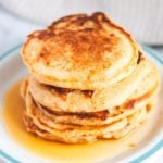 Stack of vegan sweet potato pancakes with syrup