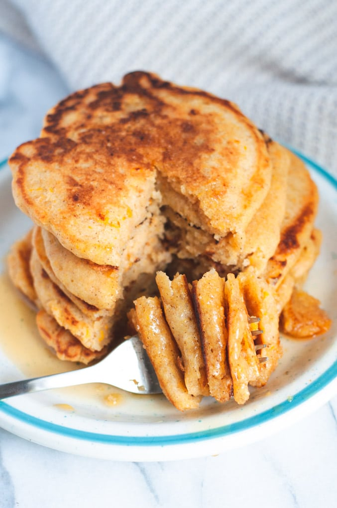 Stack of vegan sweet potato pancakes cut with a fork