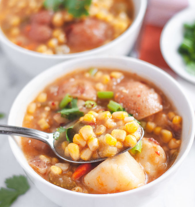 Bowl of vegan chipotle corn chowder with spoon of soup
