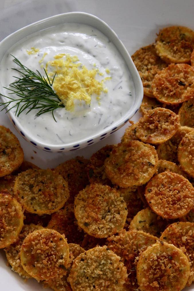 Squash chips next to bowl of white dipping sauce