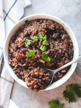 Bowl with a spoonful of black beans and brown rice