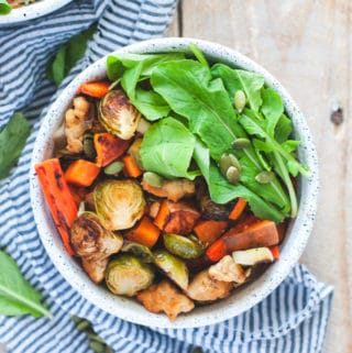 Roasted fall vegetables with arugula and pumpkin seeds