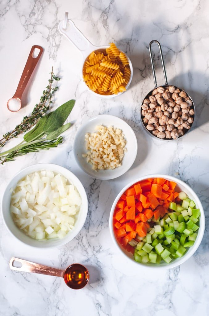 Ingredients for chickpea noodle soup: onions, carrots, celery and spices