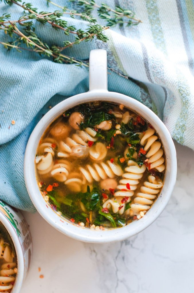 Chickpea noodle soup from above with fresh thyme in the background