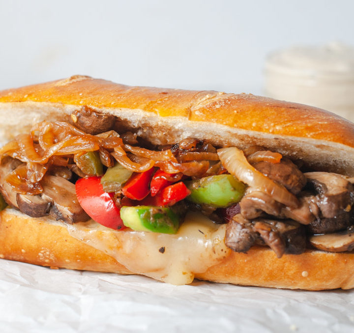 Close up of mushroom philly cheeseteak with provolone cheese