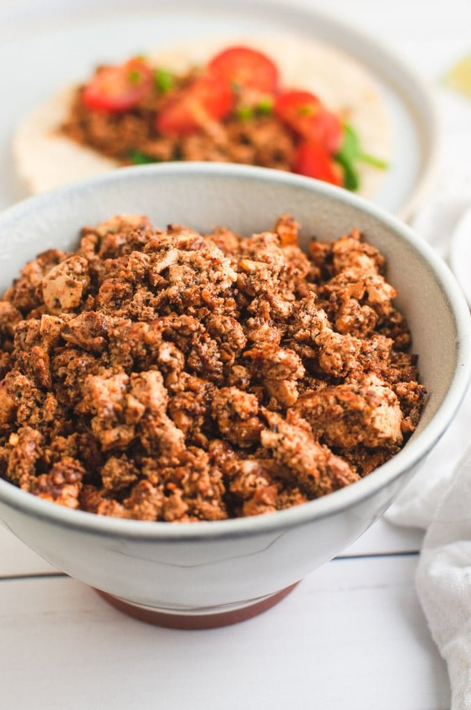 Close up of crumbled tofu chorizo in a white bowl