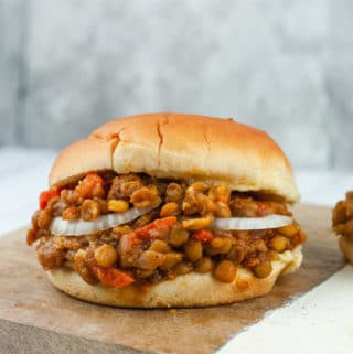 Close up of lentil sloppy joes on a white burger bund