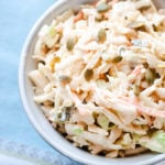 Close up of creamy texture of coleslaw in a bowl