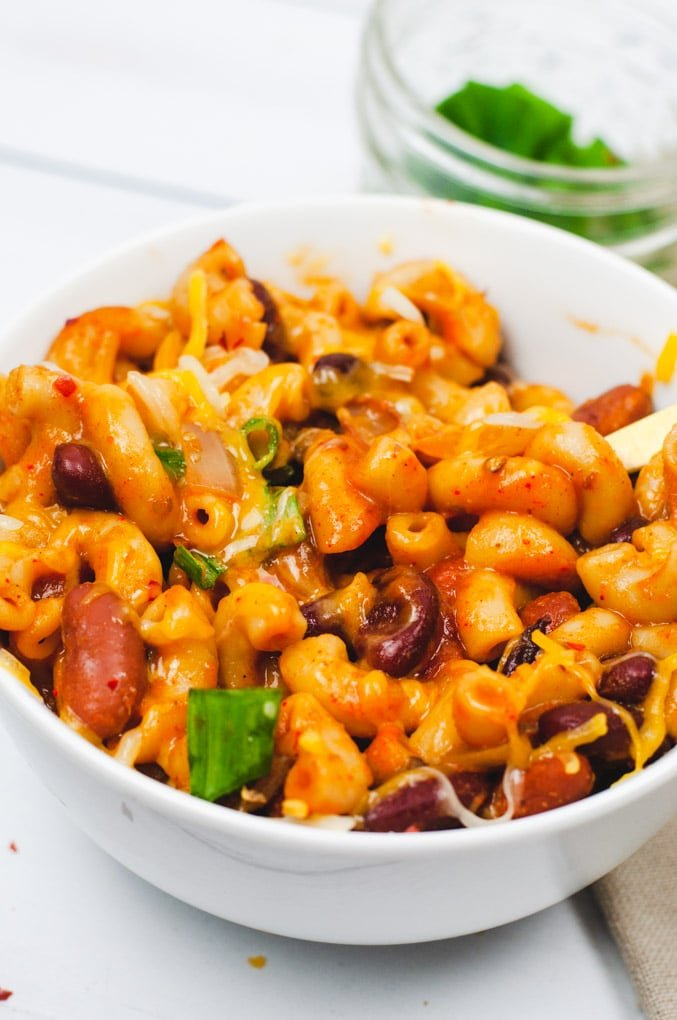 Close up of vegetarian chili mac shows creamy looking pasta and chopped green onions