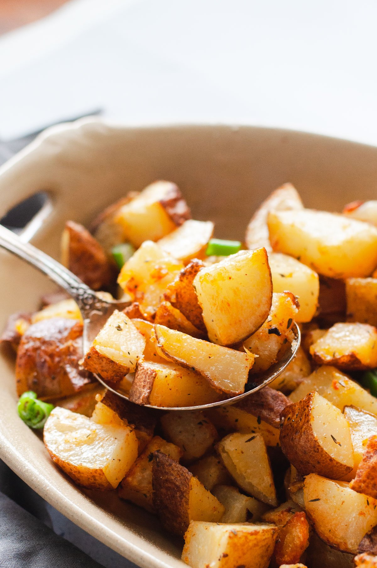 Close up view of potatoes being scooped with a spoon