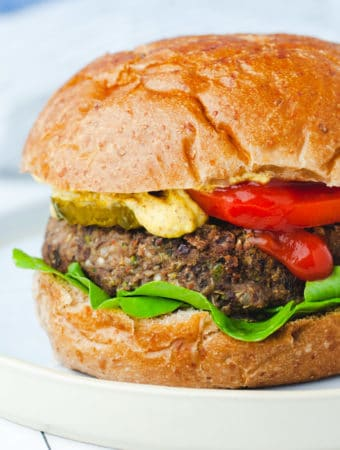 Close up view of veggie burger on a wheat bun.