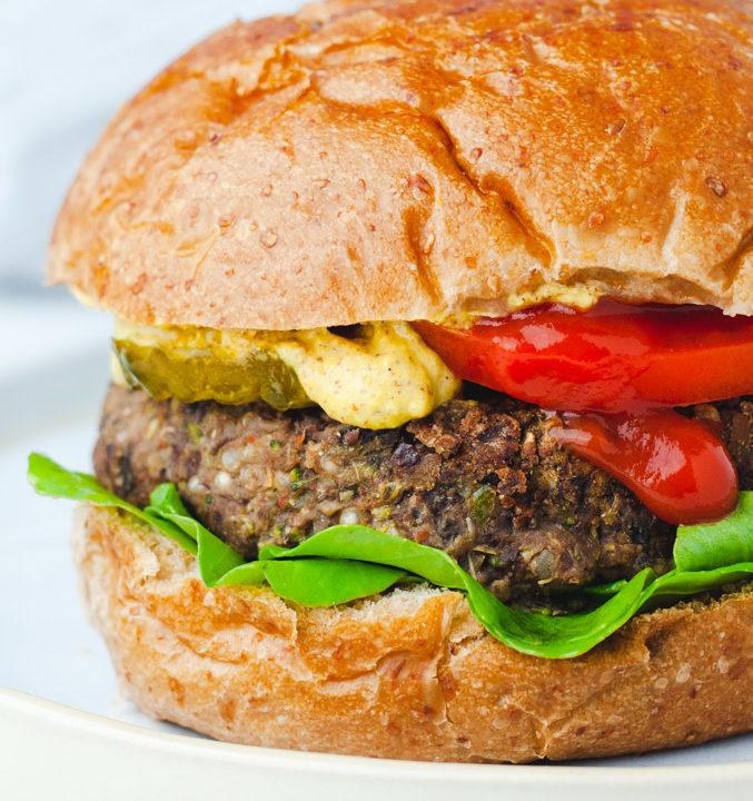 Close up view of veggie burger on a wheat bun.