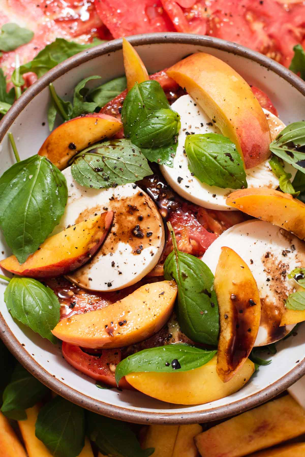 Close up of peaches, basil and mozzarella