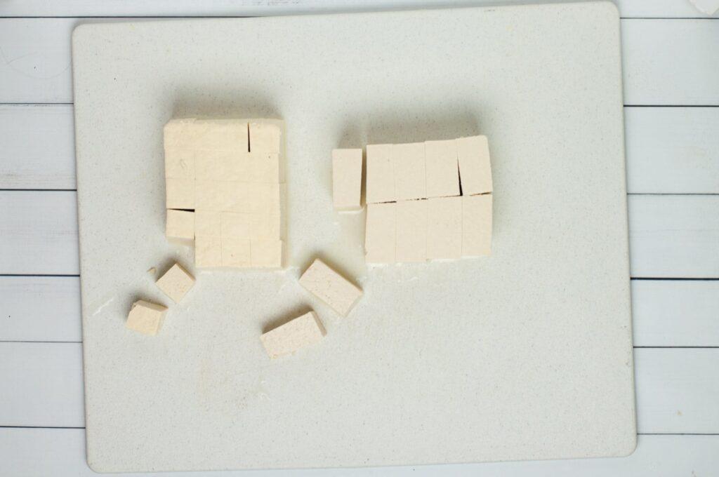 Sliced tofu on cutting board