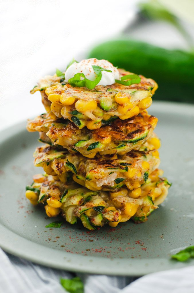 Four zucchini fritters stack on top of each other