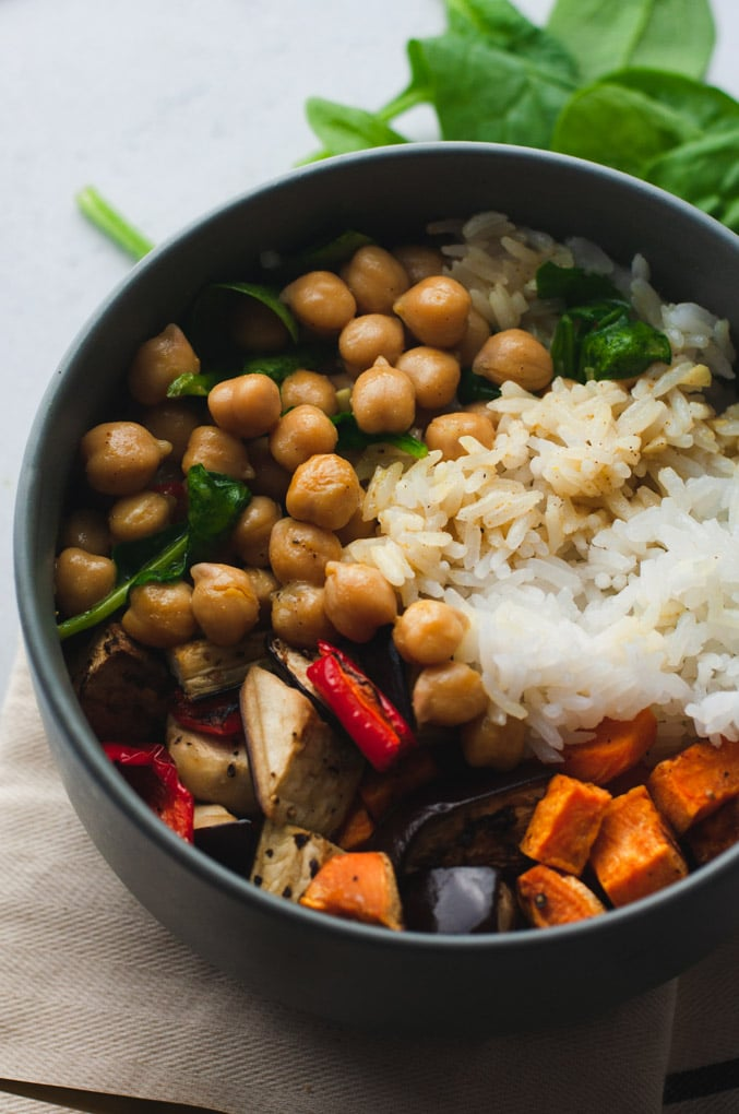 Gray bowl filled with rice, roasted vegetables and chickpeas