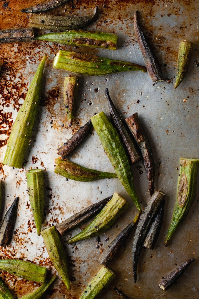 Silver sheet pan with oven roasted okra.