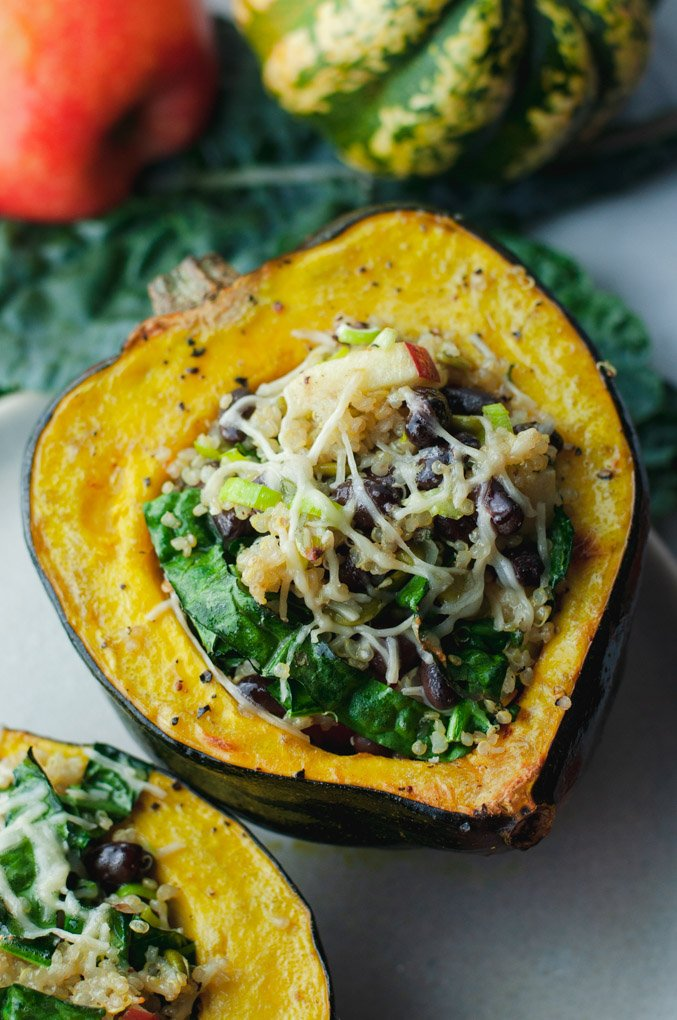 Roasted acorn squash stuffed and topped with melted parmesan cheese